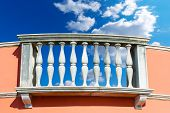 picture of balustrade  - Old white stone balustrade with blue sky and clouds in the background - JPG