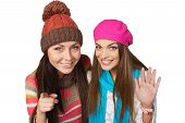 stock photo of peep  - Funny picture of two girls peeping into camera and waving you - JPG