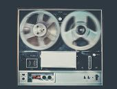 image of cold-war  - Vintage retro style photo with grain of reel to reel tape deck - JPG