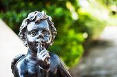 stock photo of shhh  - Boy Angel statue on stairway Shhh  - JPG