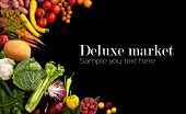 picture of eatables  - studio photo of different fruits and vegetables on black backdrop - JPG