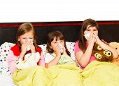 pic of influenza  - Sick little girls suffering from bad influenza staying in bed - JPG