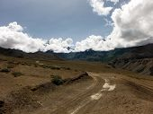 foto of mustang  - A trading road in the lower Mustang Annapurna Himalayan area of Nepal in monsoon season featuring a desert - JPG