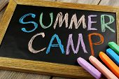 picture of sticks  - Text Summer camp written with chalk on chalkboard - JPG