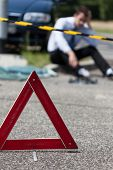 pic of premises  - Closeup of area of a car accident and a man - JPG