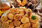 Постер, плакат: closeup of a plate with panellets and some roasted chestnuts and sweet potatoes and sweet wine ty