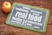 foto of real  - real food word cloud on a blackboard with an apple  - JPG