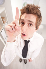 foto of fussy  - fussy clerk rising up his finger to teach you what to do - JPG