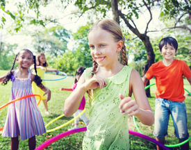 stock photo of hulahoop  - Group of Children Playing Hulahoop Concept - JPG