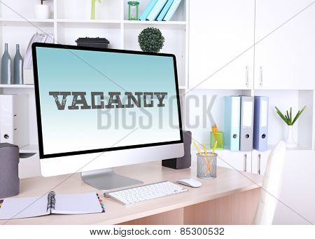 Office workplace with vacancy sign