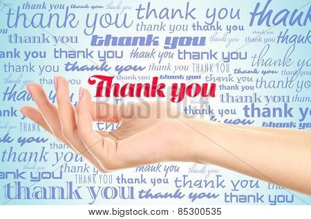Hand with phrase Thank You on color background