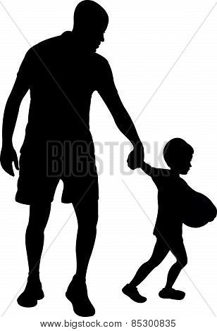 father and son walking, boy want to play with ball