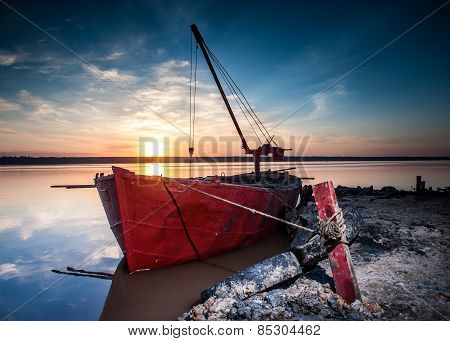 Red boat on a salt lake in Ukraine, Odessa