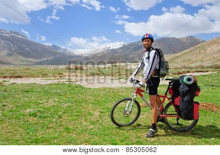 Cyclist With A Large Backpack Standing On The Background Of The Turkish Mountains