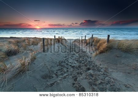 Sand Path To Beach On North Sea At Sunset