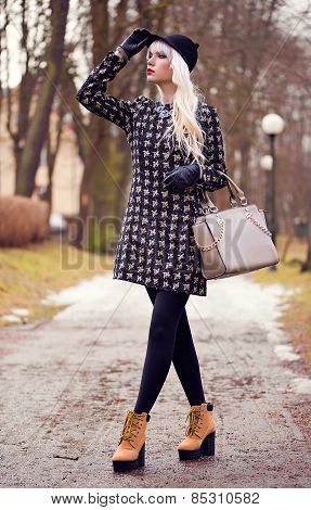 Fashion Young Woman With Bag Outdoors
