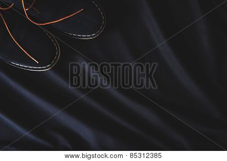 men's suede shoes on a black background