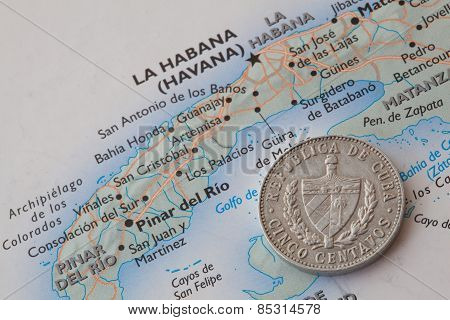 Cuban Coin Lying On A Map