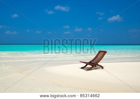 Beach Lounger On Sand Beach.