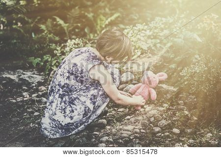 Girl Plays With A Plush Bunny Outside - Retro