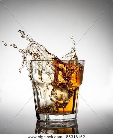 splash of whiskey with ice