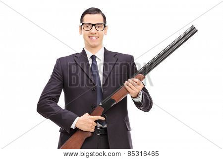 Male bodyguard holding a shotgun isolated on white background