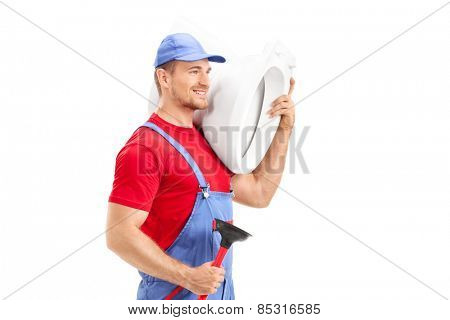 Male plumber carrying a toilet and holding a plunger isolated on white background