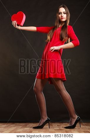 Woman Holding Heart In Red Dress.