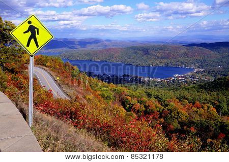 Pedestrian Crossing Sign at Top of Autumn Mountain with Lake