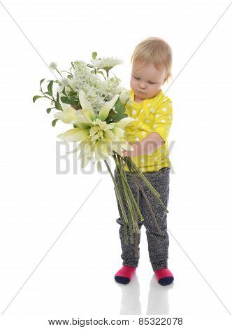 Happy Infant Child Baby Toddler Standing With Boquet Of Flowers