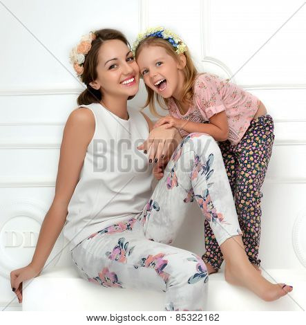 Mother And Four Years Old Daughter Laughing Together Hugging Smiling