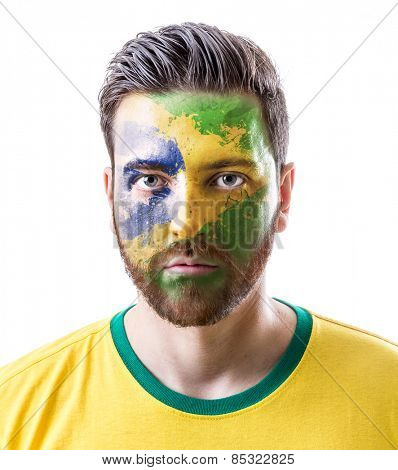 Man with his face painted with the Brazilian Flag on white background