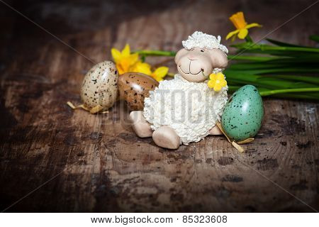 Easter decoration with cute lamb and eggs