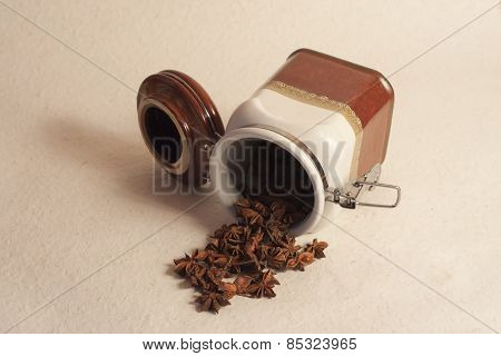 a pot of star anis spices, photo studio