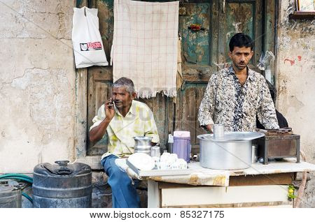 Ahmedabad, India - December 28, 2014:  Unidentified Indian Man Selling Tea At Street In Ahmedabad