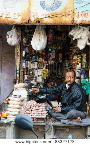 Ahmedabad, India - December 28, 2014: Unidentified Indian Man Selling Variety Product At Market