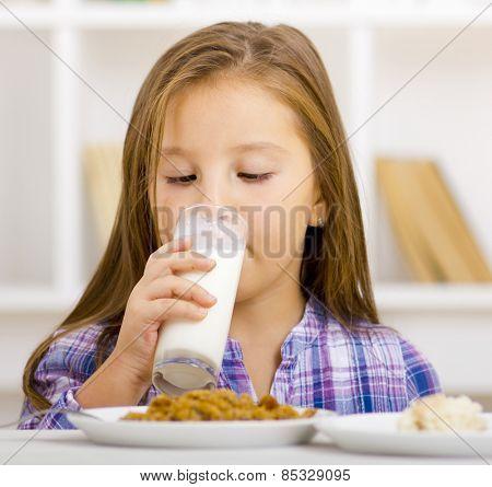 Cute child drinking milk