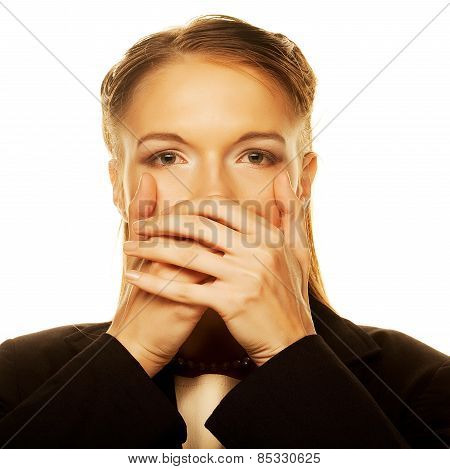 businesswoman covering with hand her mouth