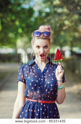 Beautiful Young Woman In Fifties Style With Candy