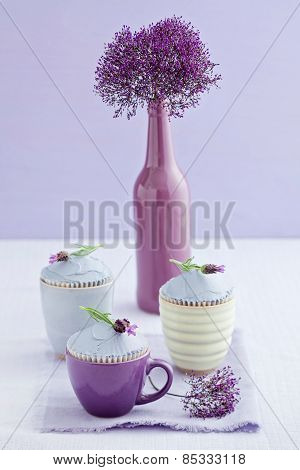 Three lavender cupcakes