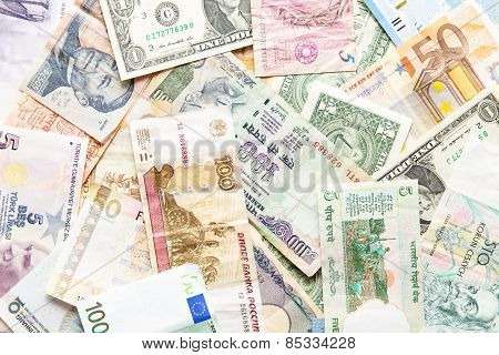 Many Different Currencies As Background