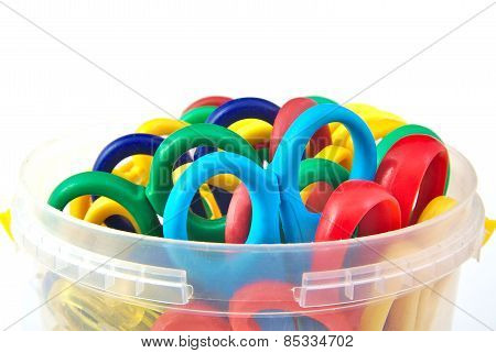 Set of child colourful scissors on a white background