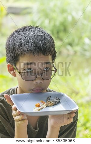 Pensive Boy Looks At Fish Bone Eaten Clearly On Plate