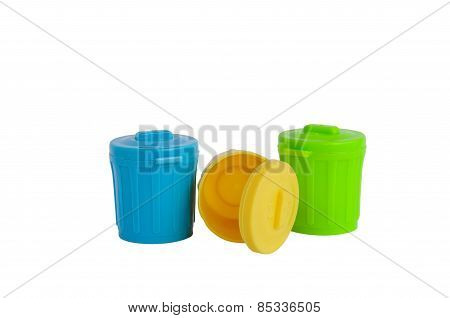 Green, Yellow And Blue Plastic Trash Cans Isolated