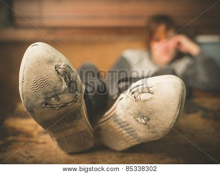 Woman Resting Feet On Table