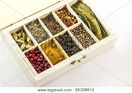colorful spices in a wooden box