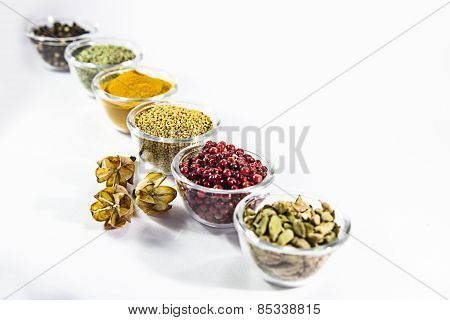 colorful spices in glass containers