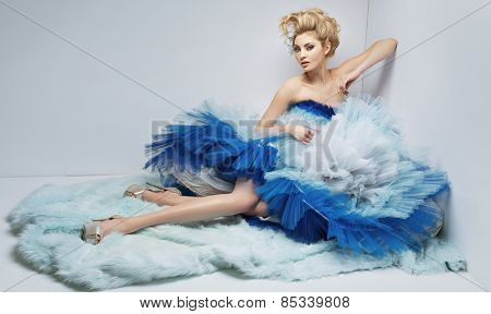 Elegant lady lying on the floor