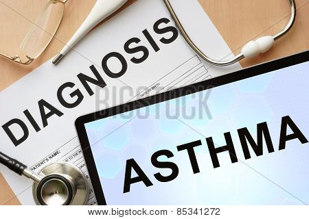 Tablet with diagnosis asthma and stethoscope.