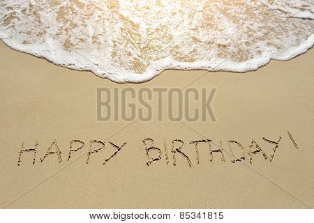 Happy Birthday Written On Sand Beach